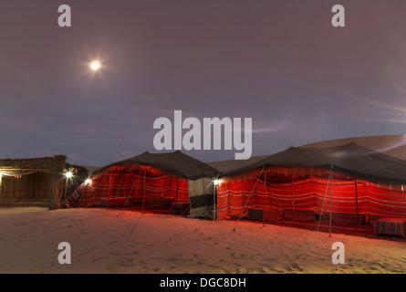 Bedouin tents at night in desert, Adu Dhabi, United Arab Emirates - Stock Photo