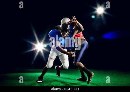 Two american footballers playing - Stock Photo