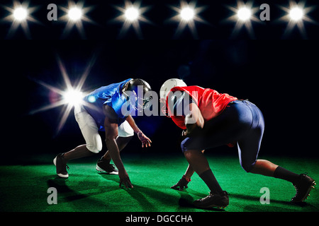 Two american footballers playing head to head - Stock Photo