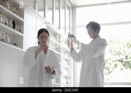 Chemistry students in lab - Stock Photo
