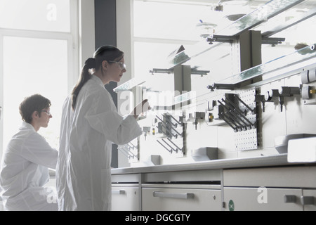 Chemistry students in laboratory - Stock Photo