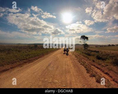 Senior man riding horse on dirt track, Uruguay - Stock Photo
