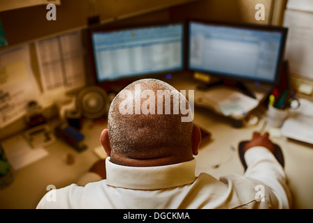 Mature man working in control room of manufacturing plant - Stock Photo