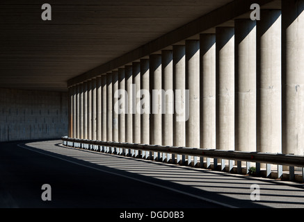 Tunnel with columns in black and white photo, abstract tunnel photo, black and white photo, architecture details - Stock Photo
