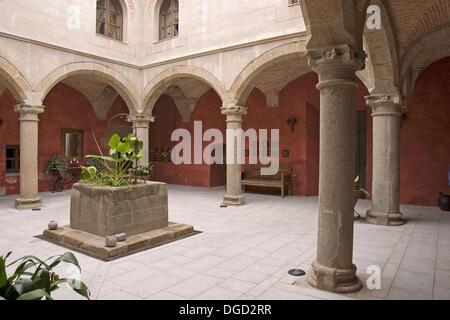 Cloister of the Franciscan convent of Nuestra Señora de la Luz, Brozas, Cáceres, Extremadura, Spain - Stock Photo