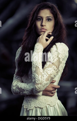 Young woman in antique wedding dress - Stock Photo