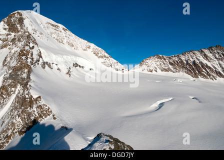 View from Jungfraujoch summit towards Monk Summit, Swiss Alps, Switzerland, Europe - Stock Photo