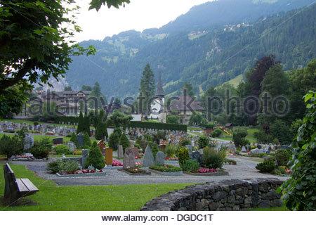Cemetery in Lauterbrunnen town, Bernese Oberland, Switzerland - Stock Photo