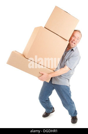 A man is painfully carrying boxes. - Stock Photo