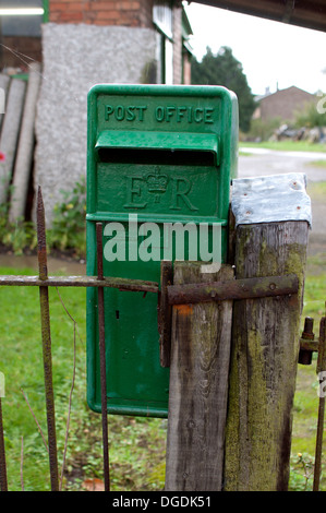 An old green disused post box - Stock Photo
