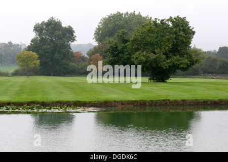 Broughton Park and castle moat, Oxfordshire, England, UK - Stock Photo