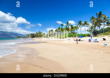 Kamaole Beach with some palm trees and people in Maui, Hawaii. - Stock Photo