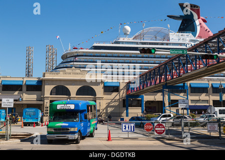 Shuttle bus disembarking passengers from Carnival Magic cruise ship at Galveston Texas USA - Stock Photo