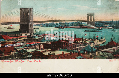 Vintage postcard depicting the Brooklyn Bridge crossing over the East River circa 1900 - Stock Photo
