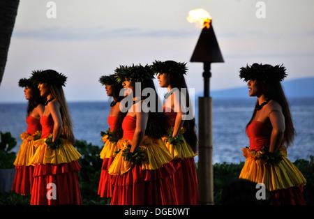 Hula dancers at a luau presentation in a resort, Lahaina Beach, Maui, Hawaii, USA - Stock Photo