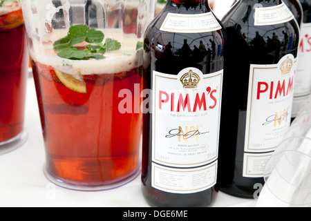 Two bottles and a jug of Pimm's - Stock Photo