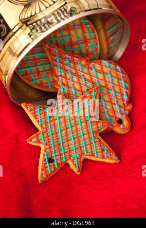 Checked red and green Christmas cookies in retro cookie jar. Gingerbreads hand made and frosted with royal icing. - Stock Photo