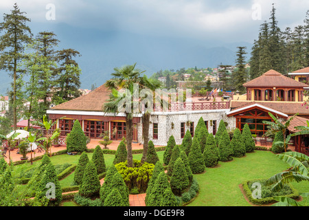 The Victoria Sapa Resort and Spa exterior and gardens in Sapa, Vietnam, Asia. - Stock Photo