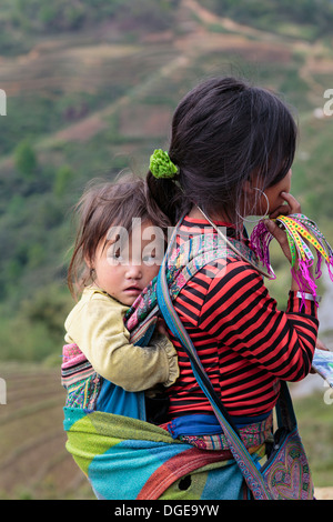 Black Hmong girls in ethnic dress in Lao Chai Village near Sapa, Vietnam, Asia. - Stock Photo