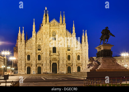 Italy Milan central city cathedral square at sunrise view on Milan duomo facade illuminated by street lamps with - Stock Photo
