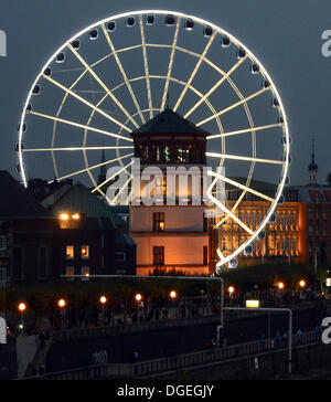 Duesseldorf, Germany. 19th Oct, 2013. A Ferris wheel is seen behind the castle tower on the Burgplatz square in - Stock Photo