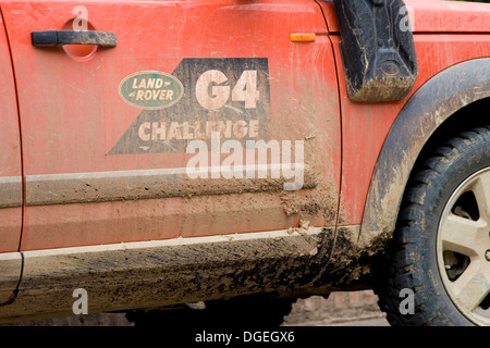 A vehicle taking part in the Land Rover G4 Challenge is parked on a city street in Luang Prabang, Laos. - Stock Photo