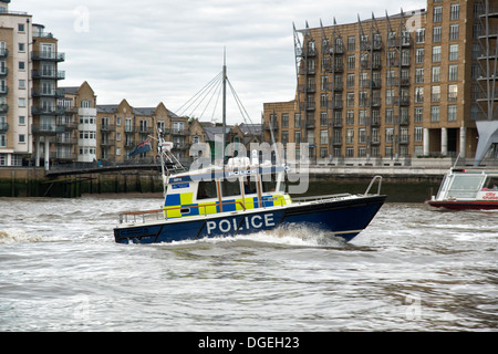 UK London Metropolitan Police Boat Sir Robert Peel II patrols the River Thames passing Limehouse East London. - Stock Photo