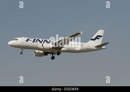 Finnair Airbus A320 on final approach - Stock Photo