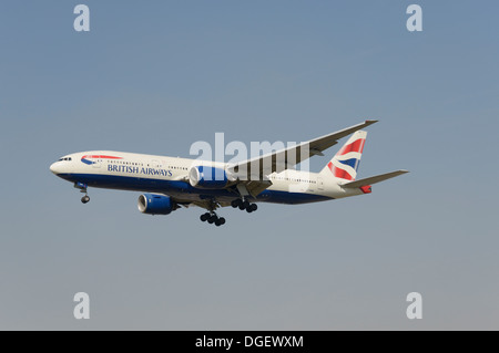 British Airways Boeing 777-236ER on final approach - Stock Photo