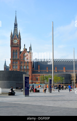 St Pancras International train station clock tower seen from emodelled Kings Cross Square - Stock Photo