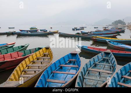 Painted boats on Phewa Lake - Pokhara, Pokhara Valley, Gandaki Zone, Nepal - Stock Photo