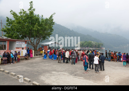 Deovtees waiting for a boat ride to Tal Barahi Temple on Phewa Lake - Pokhara, Pokhara Valley, Gandaki Zone, Nepal - Stock Photo