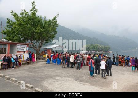 Deovtees waiting for a boat ride to Tal Barahi Temple on Phewa Lake - Pokhara, Pokhara Valley, Gandaki Zone, Nepal - Stock Photo