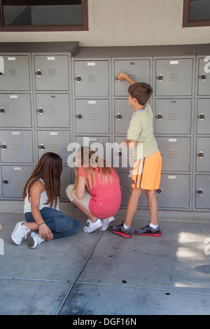 Mission Viejo, CA, middle school students place personal property in their outdoor lockers. - Stock Photo