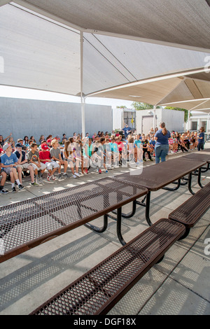 Mission Viejo, CA, middle school students listen to a lecture on correct cafeteria behavior on Pride Day. - Stock Photo