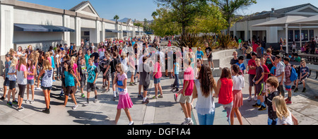 Mission Viejo, CA, middle school students socialize and relax at outdoor recess. - Stock Photo