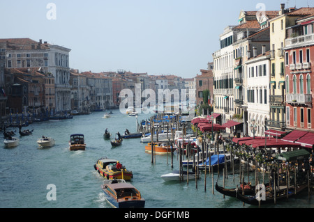 Boats traveling on the Grand Canal in Venice Italy. Gondoliers often passed this part. - Stock Photo