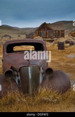Old rusted cars in field, Bodie State Historic Park, Mono County, California - Stock Photo