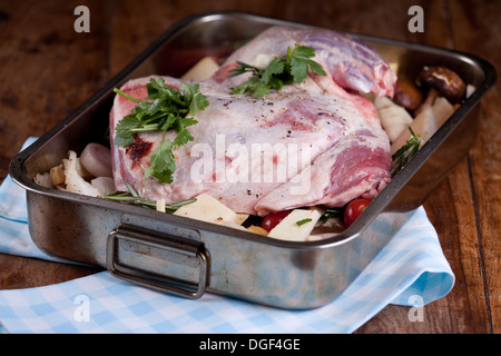 raw shoulder of lamb in the cooking tray - Stock Photo