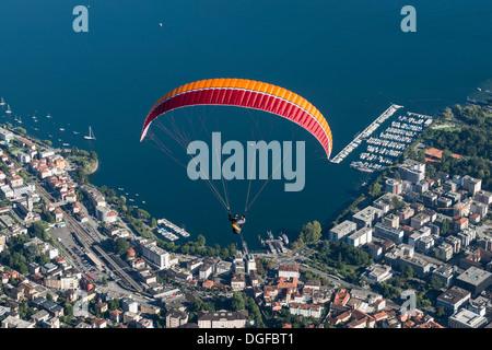Aerial view, paraglider, marina, Lake Maggiore, Locarno, Kanton Tessin, Switzerland - Stock Photo