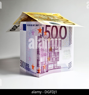 House made of euro banknotes, symbolic image for construction financing, Germany - Stock Photo