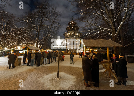 People strolling through the Christmas market at the Chinese Tower in the English Garden, Munich, Upper Bavaria, - Stock Photo