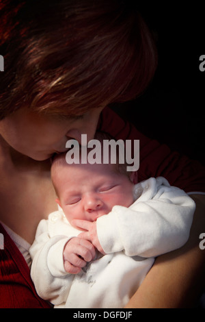 Mother holding her baby boy, 11 days, Germany - Stock Photo