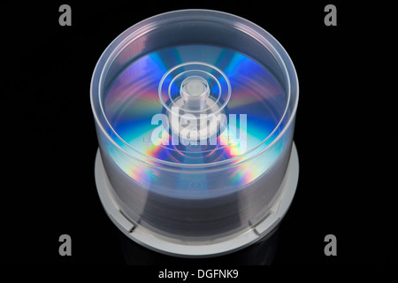 stack of dvd's, cd's on a spindle - Stock Photo