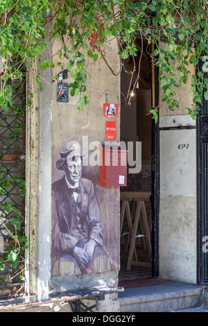 Street art outside old decrepit building which hosts artists' studios and art shows in Ackerstrasse, Mitte, Berlin - Stock Photo
