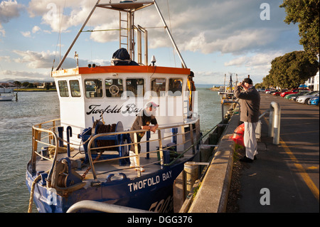 Napier, North Island, New Zealand. Fishing boat just docked at the port. - Stock Photo