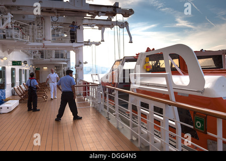 Raising lifeboat from sea back to ship Korcula Cunard Liner Queen Victoria - Stock Photo