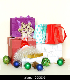 many gift boxes and colorful shopping bags on white background - Stock Photo