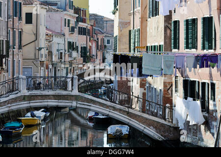 Bridge over Rio de Sant'Ana, washing hanging on washing lines, houses along a canal, Castello, Venice, Venezia, - Stock Photo