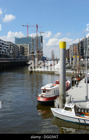 Ships are moored in the Tall Ship Harbour, Traditionsschiffhafen harbour, modern residential and office buildings, - Stock Photo